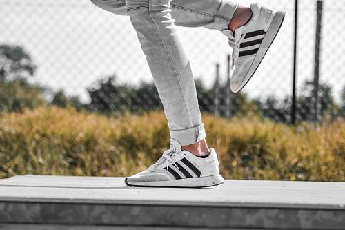 clothing person wearing white adidas sneakers shoe