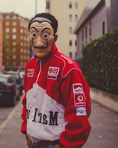 clothing selective focus photography of man wearing mask and red and white jacket human