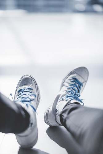 clothing selective focus photography of person wearing white Chuck Taylor Converse sneakers footwear