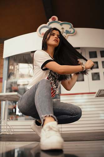 clothing woman in white t-shirt with blue denim jeans with sneakers shoe