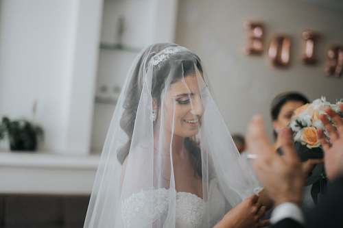 clothing woman wearing wedding veil veil