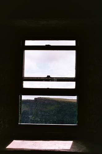 building close-up photo of windowpane window