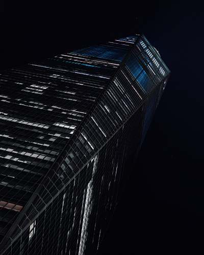 building low-angle photography of high-rise building at nighttime skyscraper