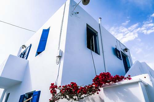 mykonos low angle view of white 2-storey house greece