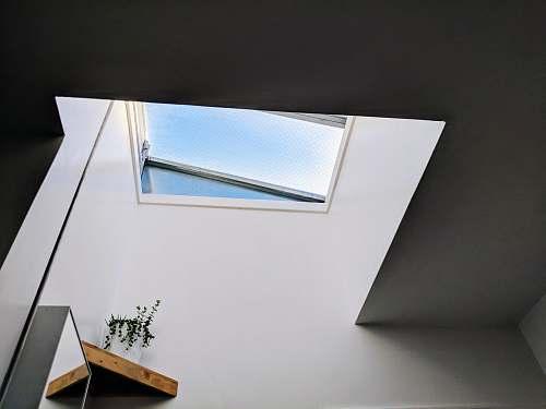 window photo of white wall paint skylight