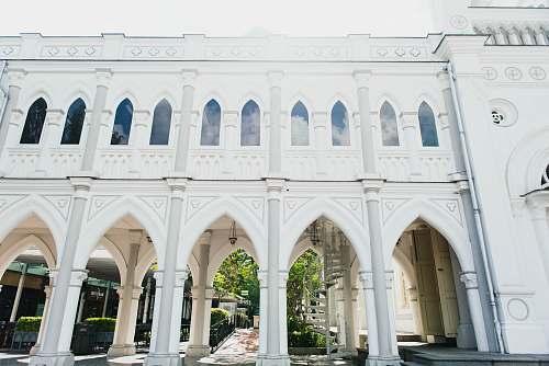 building white concrete building with pillar columns arch