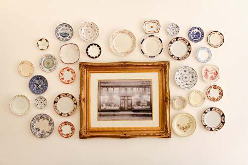 plate photo frame near assorted-color ceramic dishes london