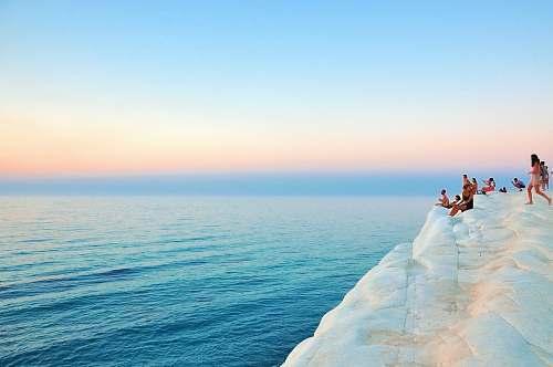 people group of people sitting on white limestone summer