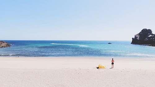 coast topless person at beach ocean