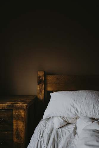 furniture brown wooden bed frame and nightstand wooden