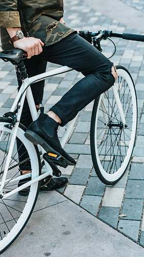 photo bike man wearing black pants riding white commuter bike fashion free for commercial use images