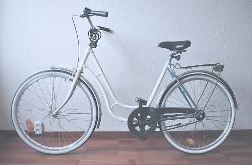 bike white cruiser bike on brown parquet floor mountain bike