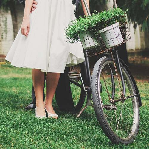bicycle person standing besides black bicycle wedding