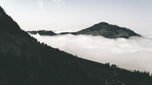 nature aerial photo of mountain and sea of clouds outdoors