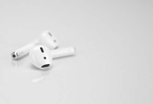 grey Apple AirPods on white surface game