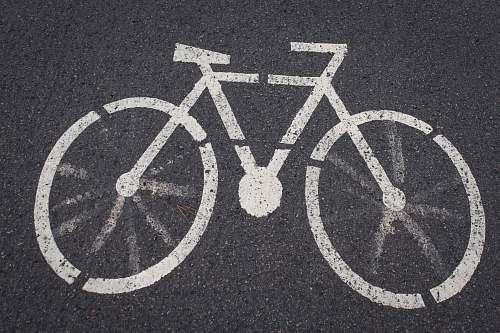grey bicycle lane road signage tarmac