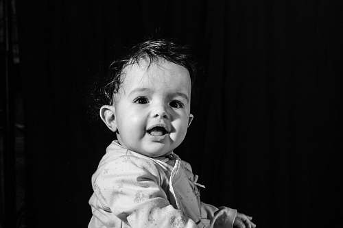 person black and white photo of toddler people