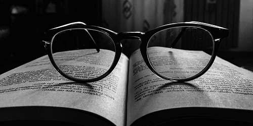 glasses black frame eyeglasses on book accessories