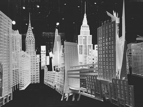 grey city buildings in grayscale photography city