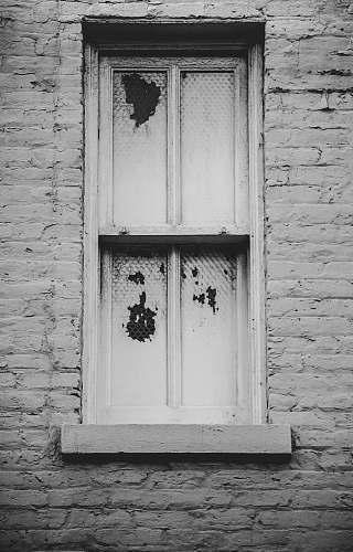 brick closed white wooden window window