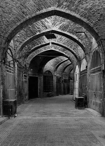 corridor empty hallway grayscale photo crypt
