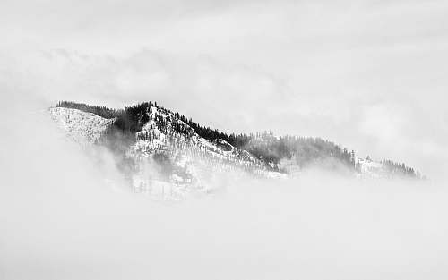mountain fog covered snow covered mountain nature