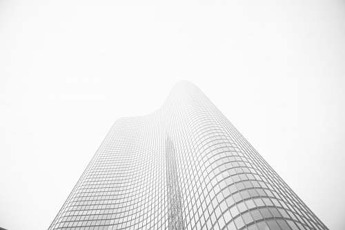 grey glass building under gray sky during daytime architecture