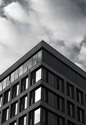 architecture gray building under cloudy sky during daytime building