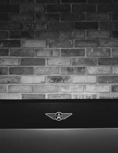 grey gray concrete brick wall logo