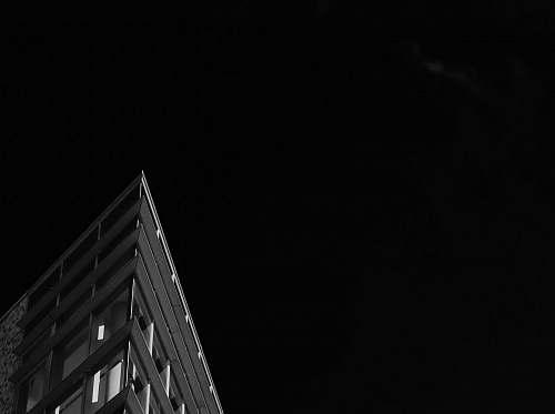 building gray concrete building under night sky architecture