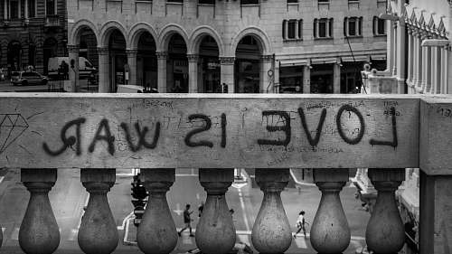 railing gray concrete wall with love is war text trieste