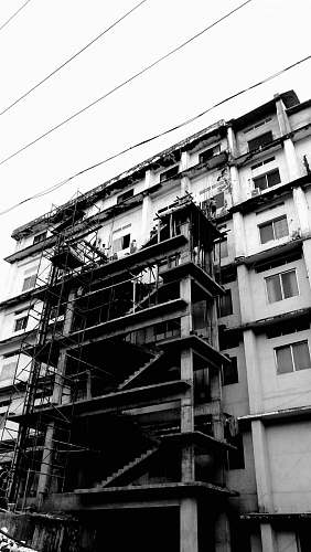 building grayscale photo of a building under construction apartment