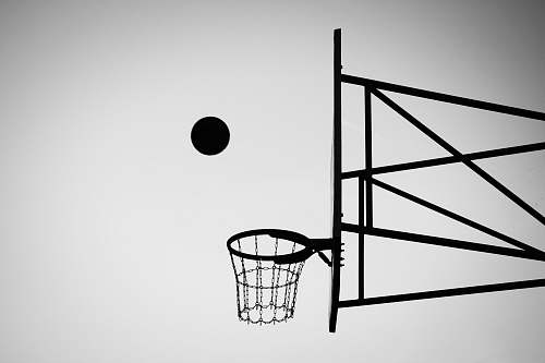 grey grayscale photo of ball about to shoot black