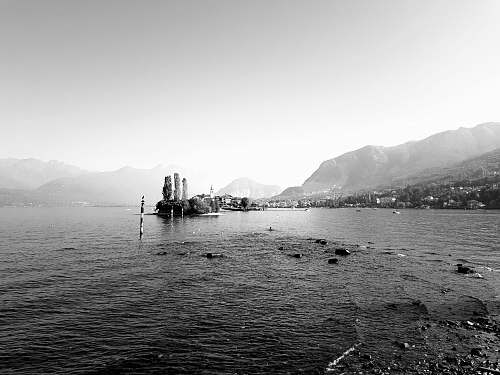 nature grayscale photo of body of water isola bella