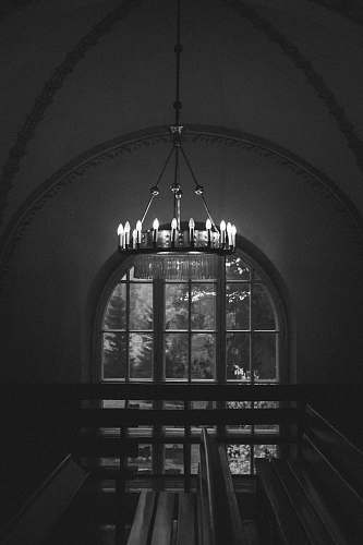 architecture grayscale photo of ceiling lamp building