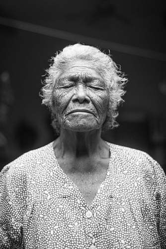 portrait grayscale photo of closed-eyes woman elderly