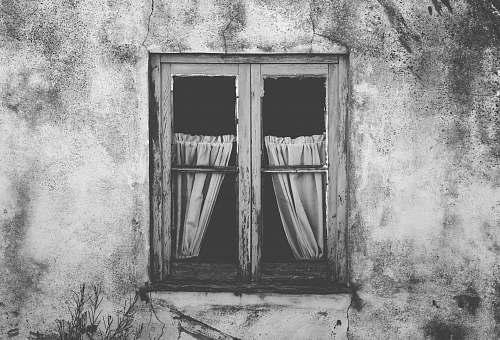 grey grayscale photo of closed window wall