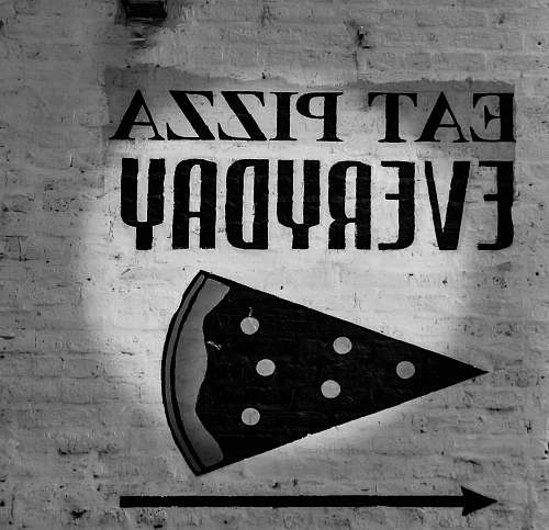 chicago grayscale photo of eat pizza everyday signage pizza