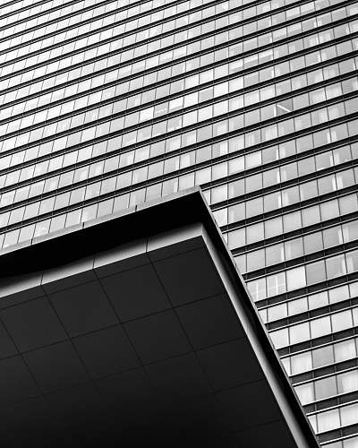 building grayscale photo of high rise building architecture