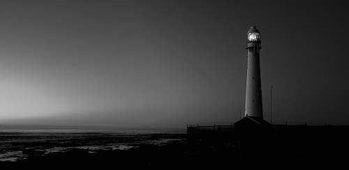 architecture grayscale photo of lighthouse building