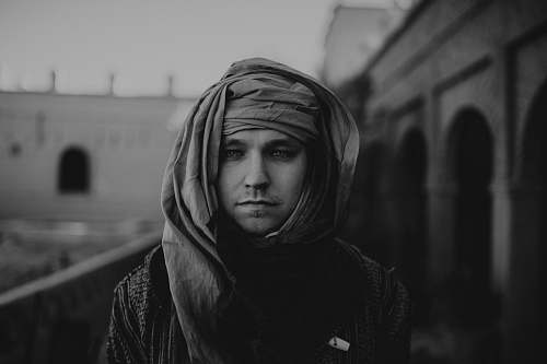 apparel grayscale photo of man wearing headscarf clothing