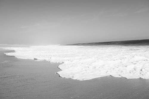 nature grayscale photo of seashore ocean