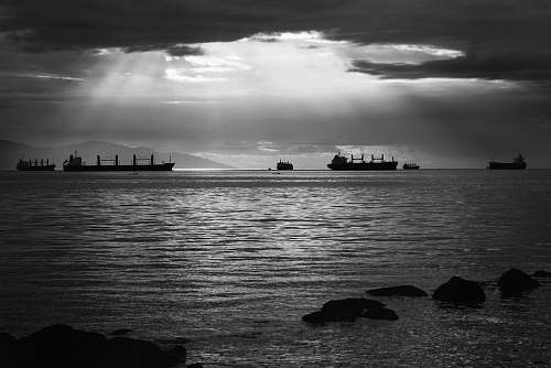grey grayscale photo of ships on water boats