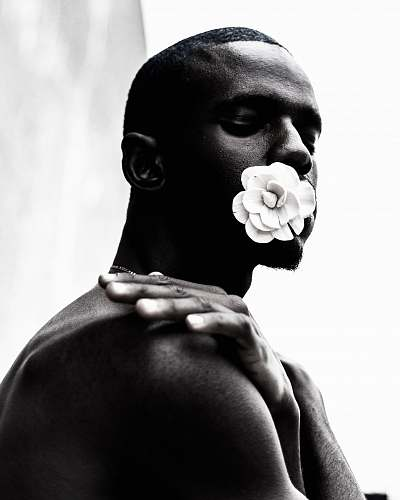 person grayscale photo of topless man human