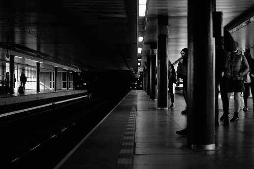 transportation grayscale photo of train station subway