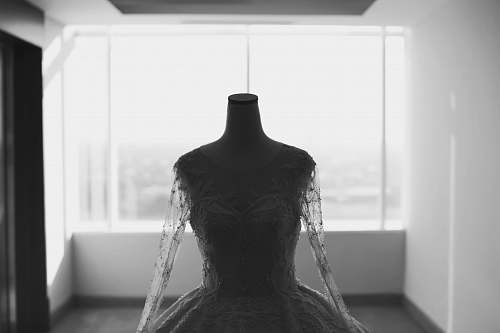 back grayscale photo of wedding dress mannequin