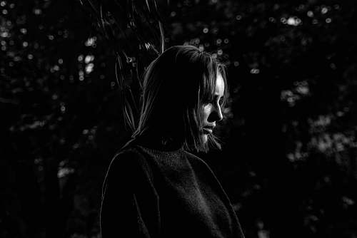 apparel grayscale photo of woman in long-sleeved shirt clothing