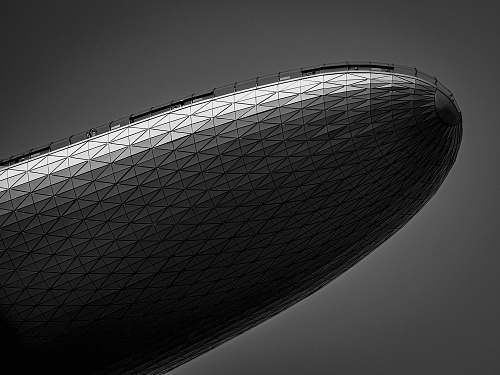 building grayscale photography of a blimp office building