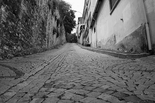 path grayscale photography of alleway walkway
