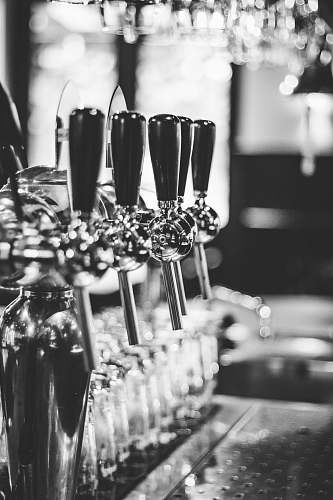 glass grayscale photography of beer tap handle grand café de keizer